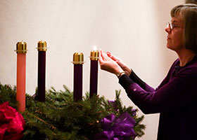 Benedictine Sister Jennifer Mechtild Horner, prioress of the Sisters of St. Benedict of Beech Grove, Ind., lights the first candle of the Advent wreath Dec. 1 at the Our Lady of Grace Monastery.